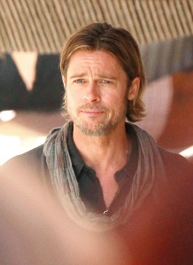 Art imitating life: Brad Pitt  as earnest scarf-wearing zombie-fighting UN worker in World War Z