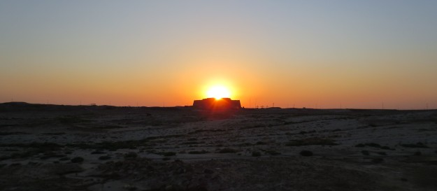 The equinox sun setting inn a satisfactory manner behind the ziggurat at Ur