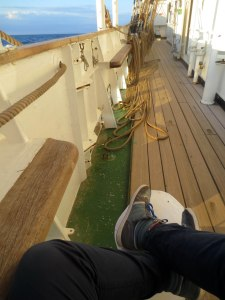 Sitting on the bits after flaking the fore-upper-tops'l halyard