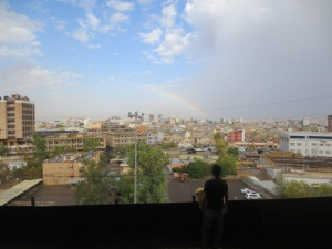 A brief break in the weather leaves a happy rainbow over soggy erbil