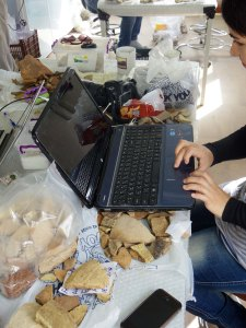A co-worker delicately balances her laptop on pottery context [209]